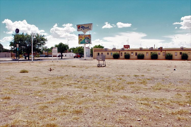Empty lot where the Royal Hotel used to be. Central Ave. (Route 66), Albuquerque, NM. July 25, 2016. Abandoned Albuquerque American West Architecture Bleak Derelict Deserted DISUSED Downtown Empty Empty Lot Historical History Litter Route 66 Royal Hotel Shopping Cart Southwest  Weathered