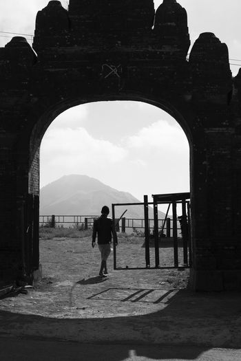 Bali's other volcano--Mt Batur Bali Copy Space Dramatic Sky INDONESIA One Person Only Silhouette Arch Architecture Black And White Built Structure Day Minimalism Monochrome Mount Batur Mountain Old Ruin One Person Outdoors Real People Rugged Terrain Southeast Asia Street Photography Strideby Travel Destinations Volcano Black And White Friday