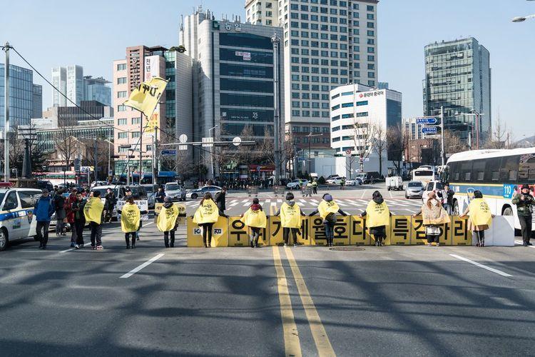 People on city street against modern buildings