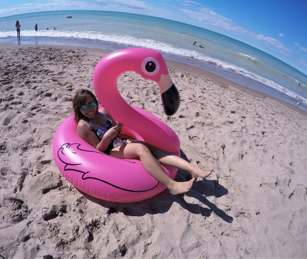 flamingo Adult Beach Child Childhood Flamingo Grand Bend, Ontario Lake Huron Lake Huron, Canada Leisure Activity Lifebuoy Lying Down Millennial Pink Nature One Girl Only Outdoors People Pink Pink Color Relaxation Sand Sand Pail And Shovel Sea Summer Vacations Water Live For The Story Place Of Heart Sommergefühle Done That. Connected By Travel