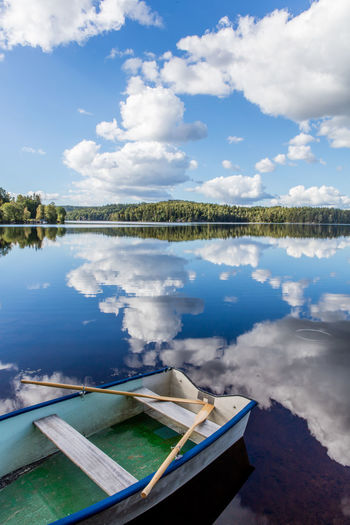 Beauty In Nature Calm Clouds And Sky Countryside Day Lake Mirror Lake Nature No People Oars Reflection Rowboat Summer Sweden Water Reflections