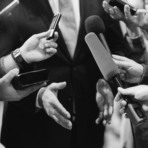 Media Interview With Business Person Black & White Business Interview Journalist Politics Publicity Event Square Standing Suit Well-dressed Answering Business Person Communication Formalwear Gesturing Human Hand Journalism Marketing Media Interview Microphone Politician Professional Occupation Sound Recording Equipment Tie Unrecognizable Person