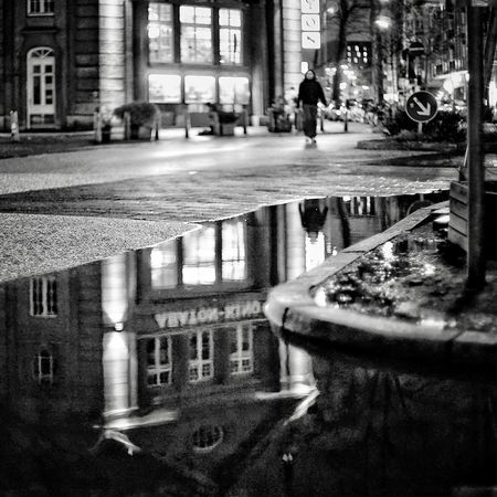 Reflections After The Rain Noir Et Blanc Black And White Built Structure Architecture Building Exterior Water City Wet Reflection Rain Street Puddle Day Building Road Rainy Season Transportation City Life Nature Outdoors Architectural Column The Street Photographer - 2018 EyeEm Awards