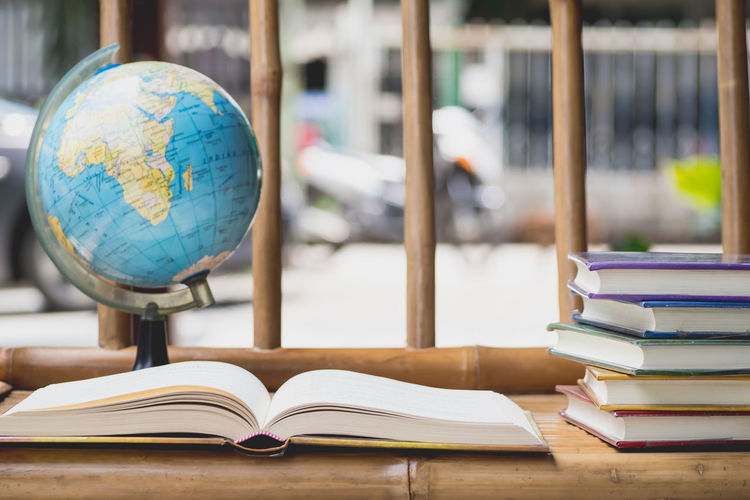 Close-up of books and globe on table