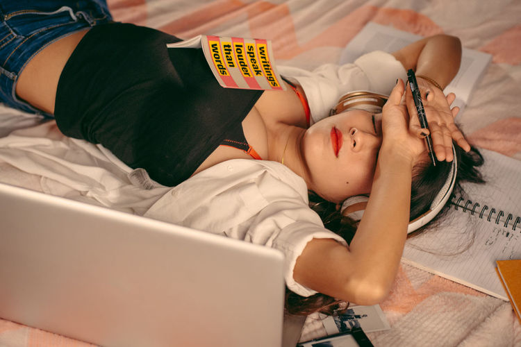 High angle view of child resting on bed at home