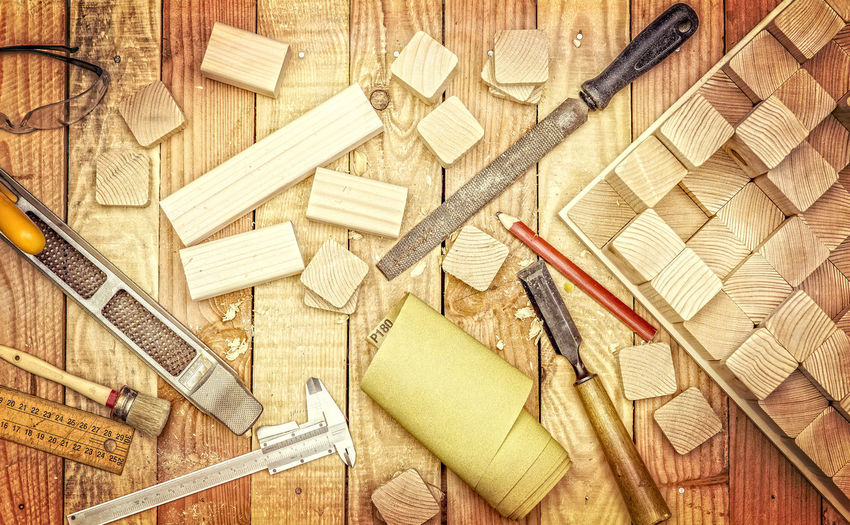 Close-up of work tools on wooden table