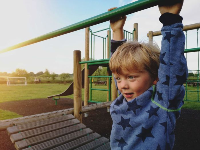 Cute boy in playground at park