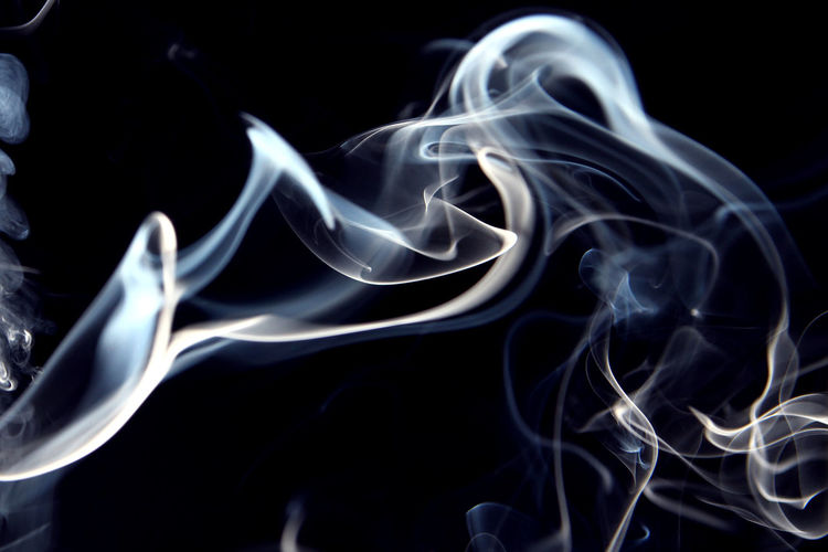 Close-up of smoke over abstract background