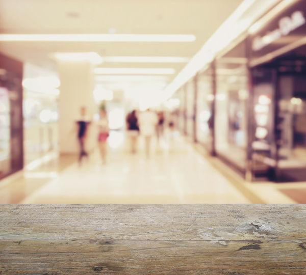 Defocused image of people walking on building