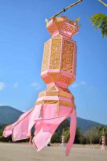 Pink Lanterns Hanging Against Sky