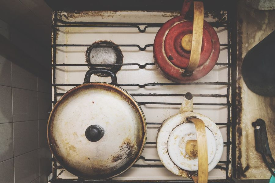 close-up overhead view of an isolated kitchen Saucepan Stove Wood Burning Stove Cooking Pan Cooking Utensil Stirring Skillet- Cooking Pan Camping Stove Colander Oven Burner - Stove Top Gas Stove Burner Ladle Boiling Frying Pan