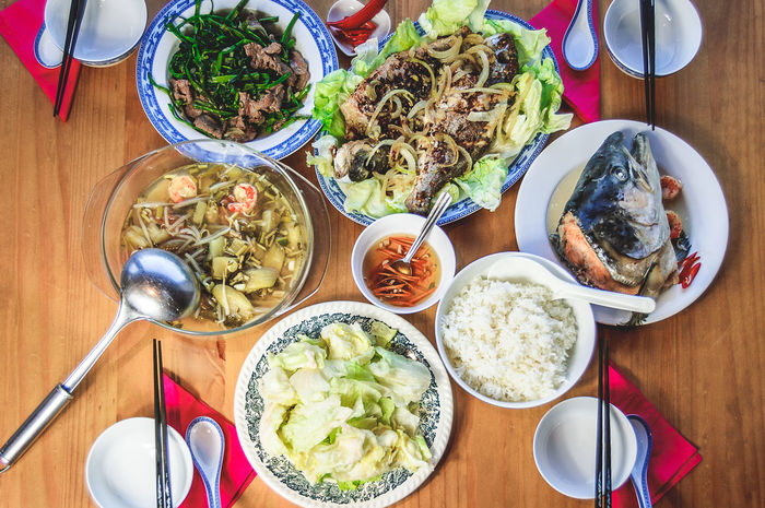 Asian Food Bowl Chopsticks Fish Fish Sauce Fish Soup Food Freshness Fried Sea Bream Healthy Eating Indoors  Lettuce Meal Nuoc Mam Plate Rau Muong Xao Thit Bo Ready-to-eat Salmon Head Serving Size Table Vietnamese Food