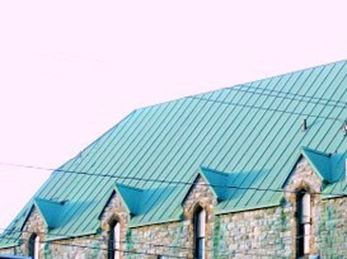 Architecture Building Exterior Built Structure Churches Cityscape Photography Cityscapes Clear Sky Close-up Corrugated Iron Day No People Outdoors Roof Sky Solar Energy Solar Equipment Solar Panel Stone Church City Stone Wall Windows