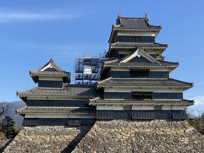 Low angle view of matsumoto castle against blue sky