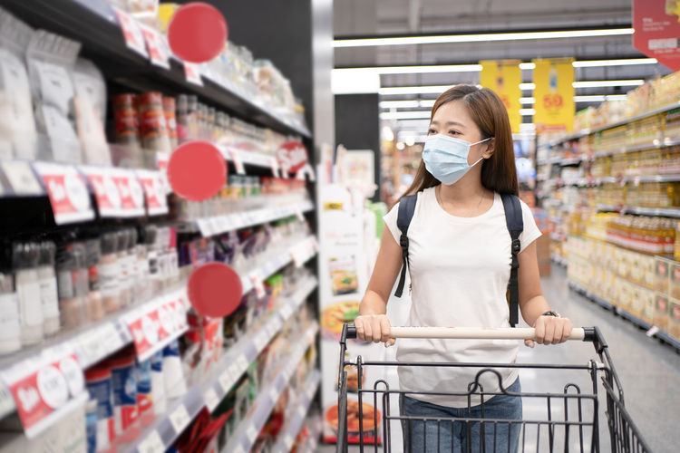 Woman wearing mask shopping at grocery store