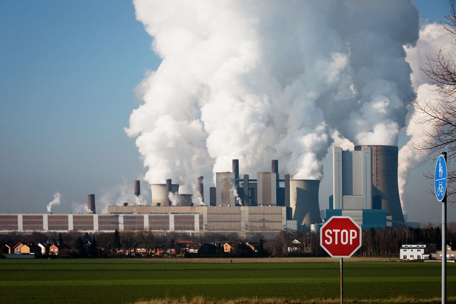 Sign Building Exterior Pollution Smoke - Physical Structure Environmental Issues Communication Sky Smoke Stack Air Pollution Warning Sign Industry Built Structure Environment No People Day Emitting Outdoors Cooling Tower Fumes Climate Change Energy Industry Coal Power Plant Stop Sign Coal Environmental Pollution