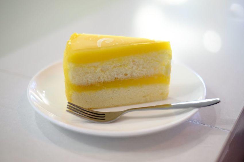 Dessert after lunch Plate Fruit Dessert Yellow SLICE Sweet Food Food And Drink Sponge Cake Blood Orange Fruitcake Cake Slice Of Cake Cheesecake Sour Taste Tart - Dessert
