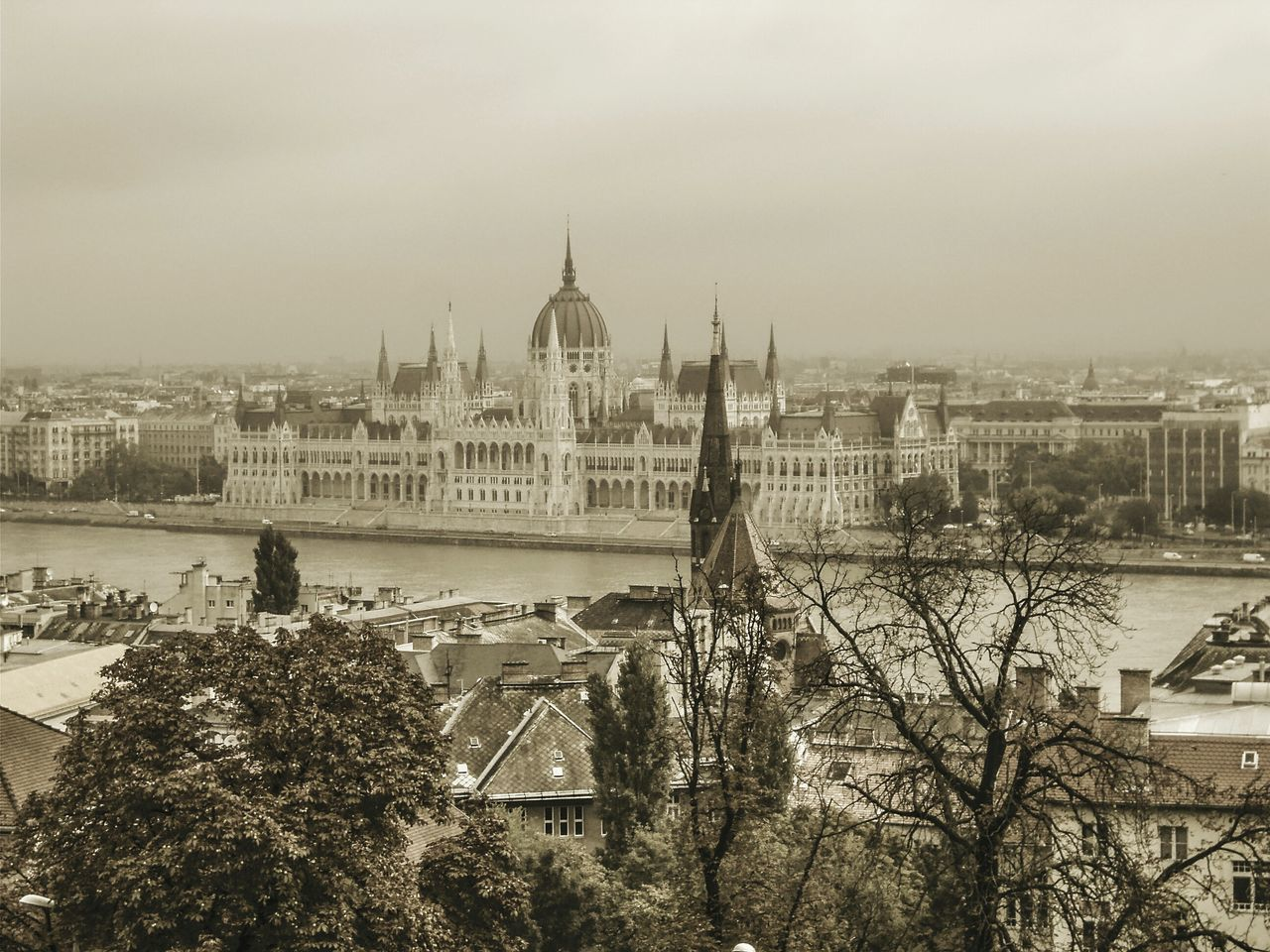 Hungarian Parliament Building and river against sky in city