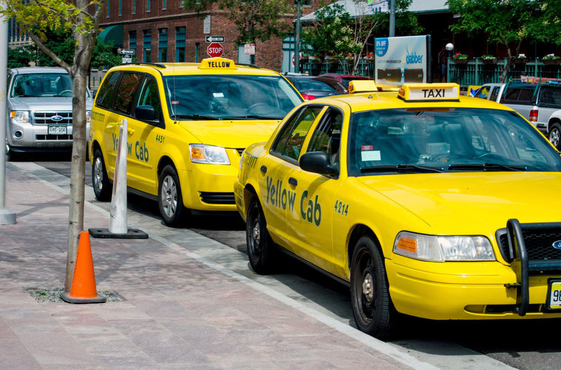 yellow taxis wait on a Denver Colorado street to pick up fares Tourism Outdoors Sidewalk Concept Marketing Advertising City People Urban Cab Clean Vehicle Empty Passenger Stop Town Taxi Private Commercial Business Street Busy Auto Background Exterior New Ad Car Downtown Idea Yellow Wheel Road Transportation Blank Communication Outside Travel Traffic America USA American Tourist Signs States Broadway Denver Colorado Waiting Job