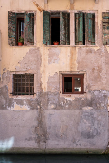 House facade in Venice, Italy. Façade House Facade Old Town Venice, Italy Abandoned Architecture Building Building Exterior Built Structure Damaged Day Entrance Facade Building History House House Facades Industry Italy No People Old Outdoors Residential District Run-down The Past Venice Wall Weathered Window