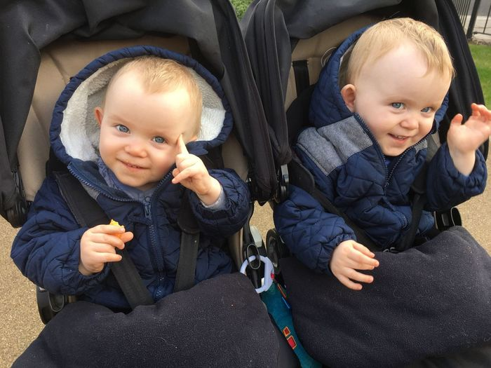 High angle view of twins baby boys in stroller