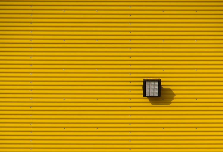 Architecture Backgrounds Building Building Exterior Built Structure Corrugated Corrugated Iron Day Full Frame Iron Metal No People Outdoors Pattern Safety Security Shutter Striped Wall - Building Feature Window Yellow The Architect - 2018 EyeEm Awards The Still Life Photographer - 2018 EyeEm Awards The Architect - 2018 EyeEm Awards
