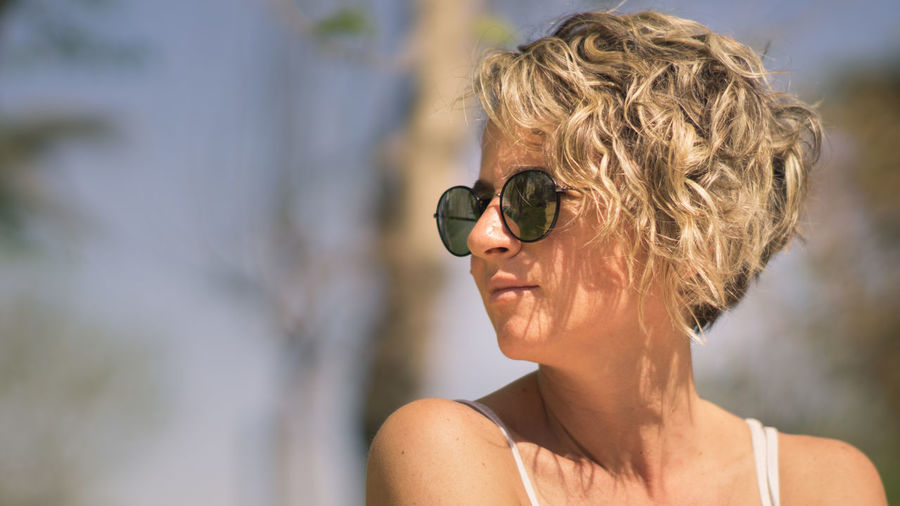 Close-up of woman wearing sunglasses while looking away