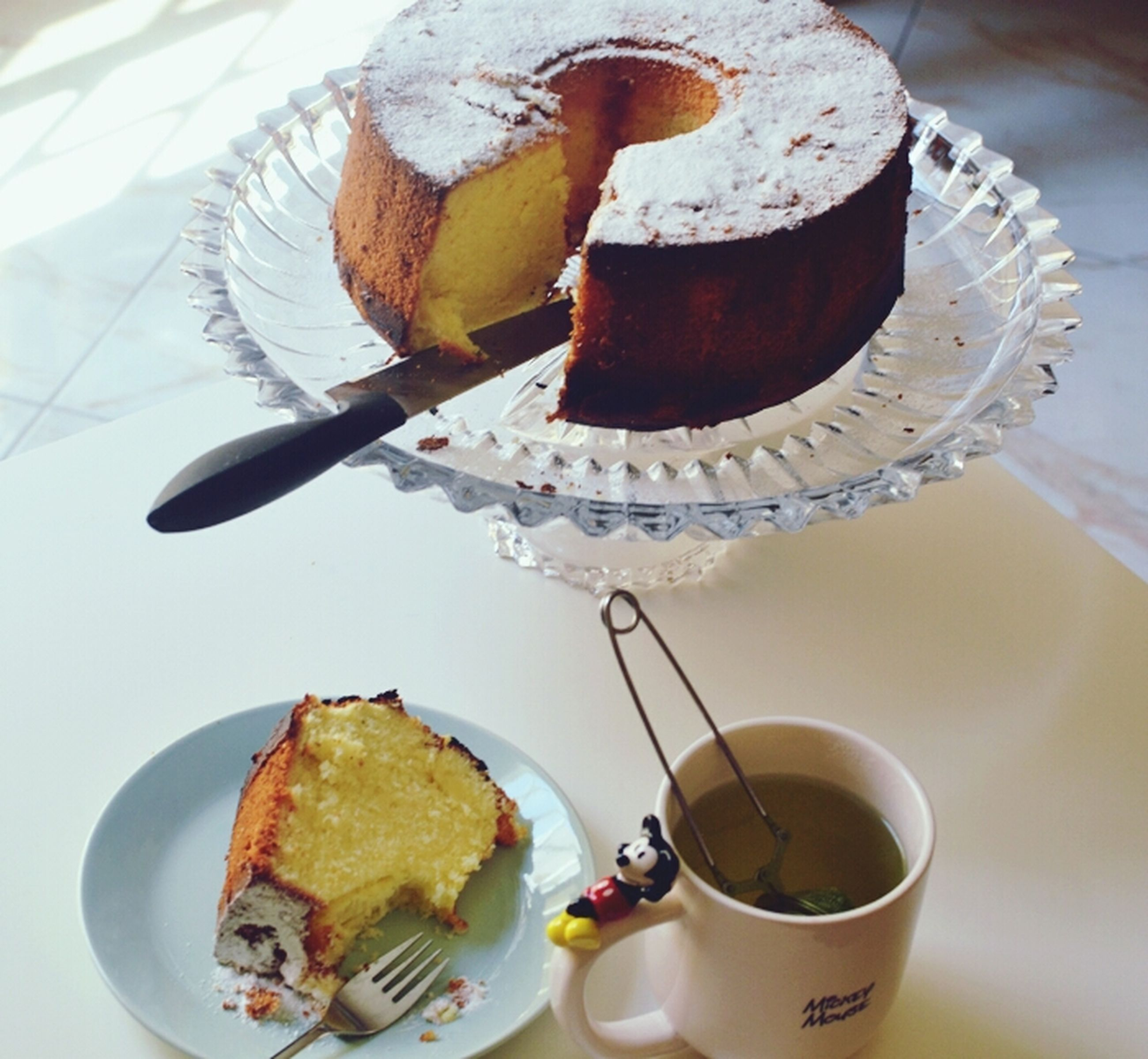 food and drink, indoors, freshness, sweet food, still life, table, plate, dessert, coffee cup, food, high angle view, indulgence, close-up, spoon, ready-to-eat, chocolate, refreshment, coffee - drink, drink, cake