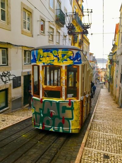 Lisbon Winter In Portugal Rebel Graffiti Tranvía Tram City Built Structure Architecture Travel Destinations Building Exterior Day No People Outdoors