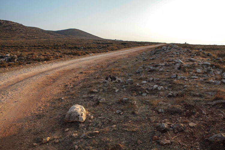 Landscape Environment Sky Nature Land Day Scenics - Nature No People Mountain Dirt Road Non-urban Scene Arid Climate Climate Outdoors Island Greek Islands