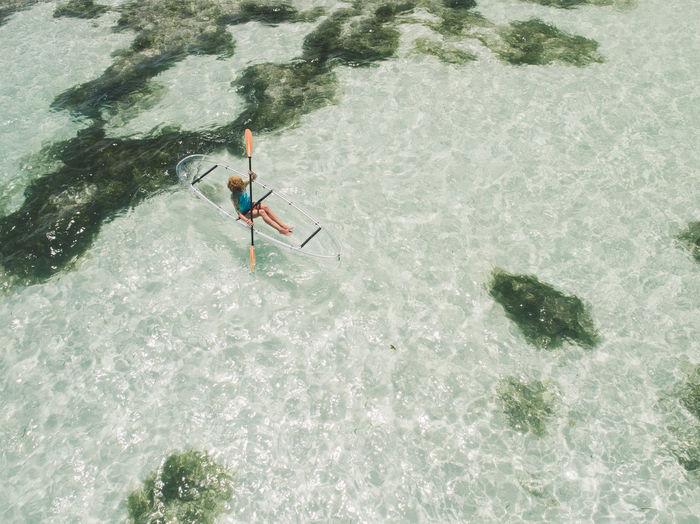 High angle view of woman boating on sea