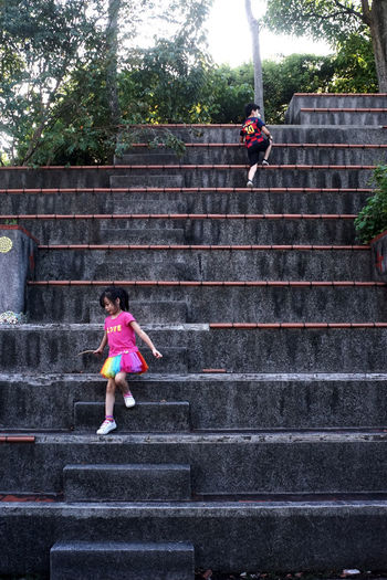 Low angle view of women standing on staircase