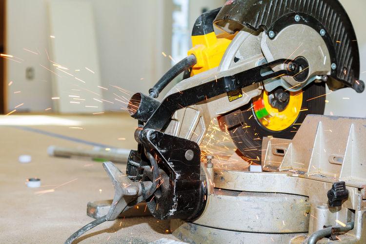 Close-Up Of Electric Saw Cutting Metal