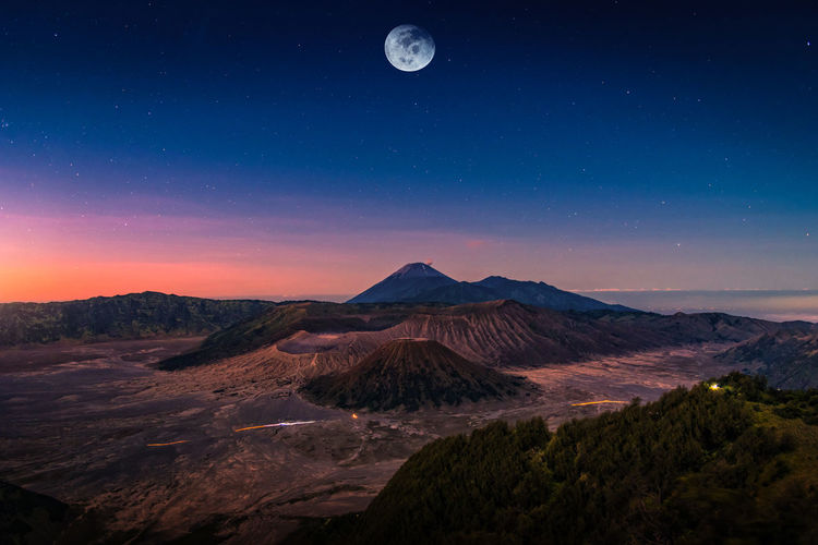 Scenic view of volcanic landscape against sky at night