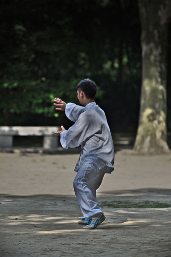 Exercising Shanghai, China Casual Clothing Excercise Time Full Length Leisure Activity Lifestyles Men One Person Outdoors Real People Thai Chi
