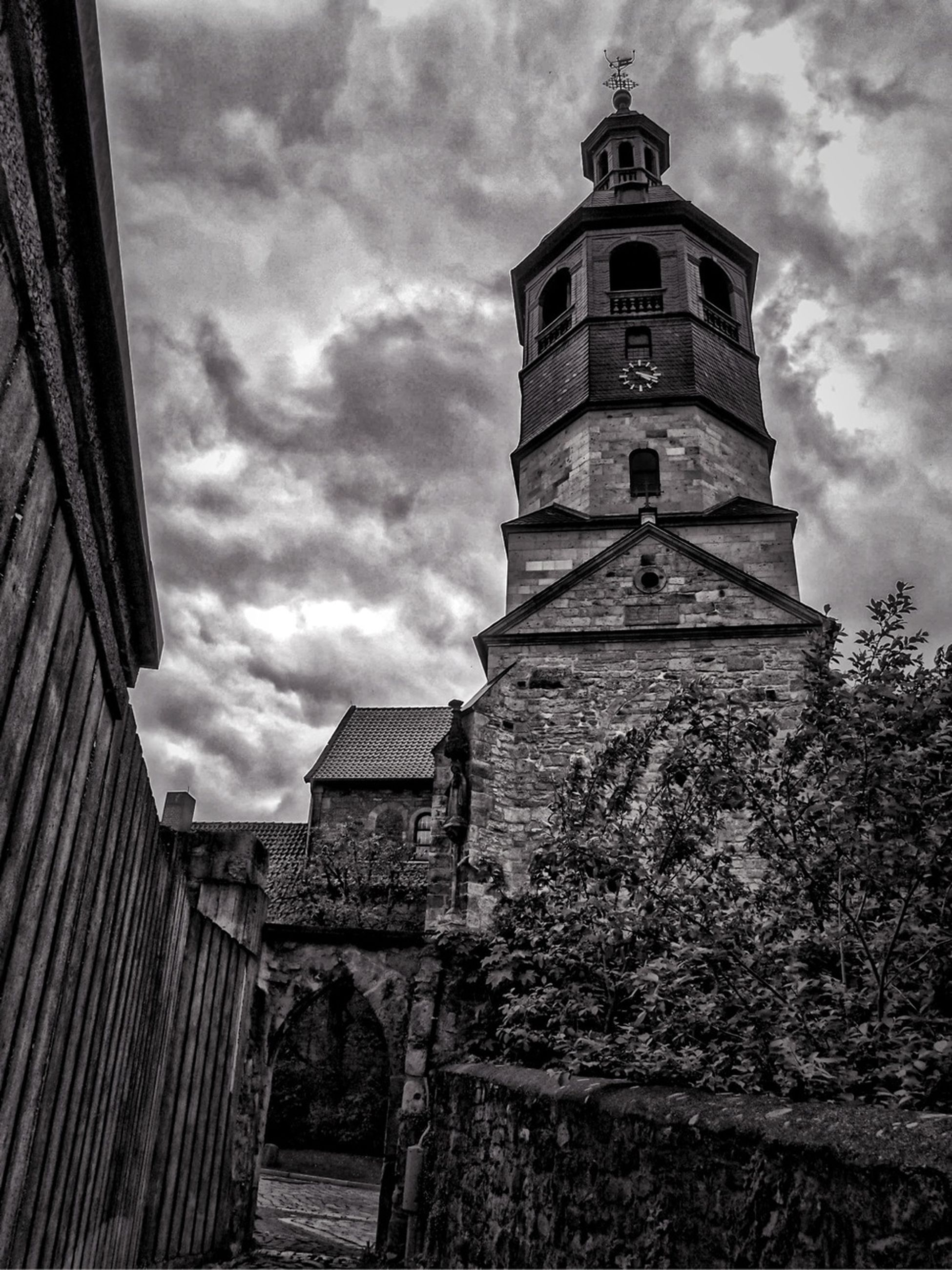 architecture, built structure, building exterior, sky, low angle view, cloud - sky, cloudy, history, tower, cloud, place of worship, church, religion, old, spirituality, day, famous place, outdoors, travel destinations