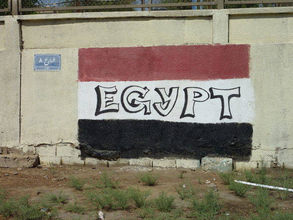 Road 8 in Maadi is not well known. Black Blue Sign Built Structure Cairo Communication Day Egypt Flag Hidden Maadi No People Outdoors Red Road 8 Shariah Street Summer Sun Tamanya Text Wall - Building Feature Water Whie