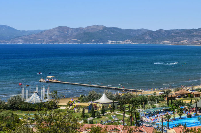 The Essence Of Summer Architecture Beauty In Nature Blue Blue Wave Boat Building Exterior Built Structure Clear Sky Coastline Here Belongs To Me Landscape Landscapes With WhiteWall Life Is A Beach Mountain Mountain Range Nature Pamucak Scenics Sea Selçuk Tranquil Scene Tranquility Water