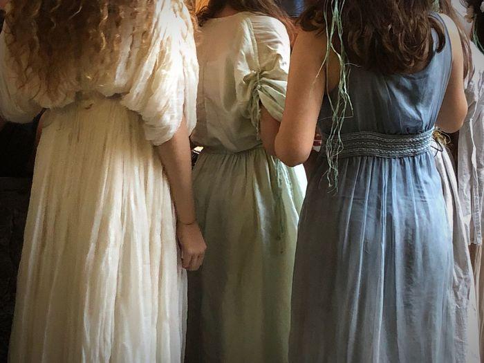 Rear view of women standing in corridor