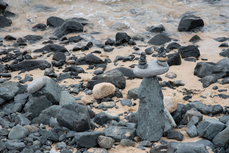 At the city beach in St Ives is a small pebble section where one can try to build pebble towers. Some are high, and some are artful like the balanced one in this picture Art Balance Beach Day High Angle View Nature No People Outdoors Pebble Rock Rock - Object Sand Sea Solid Stone Stone - Object Sunlight Water