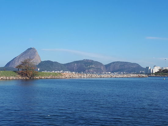 Pão de Açúcar Water Mountain Sea Blue Clear Sky Sky Architecture Building Exterior Built Structure Calm Tranquil Scene Horizon Over Water Tranquility Ocean Rocky Mountains Waterfront Remote