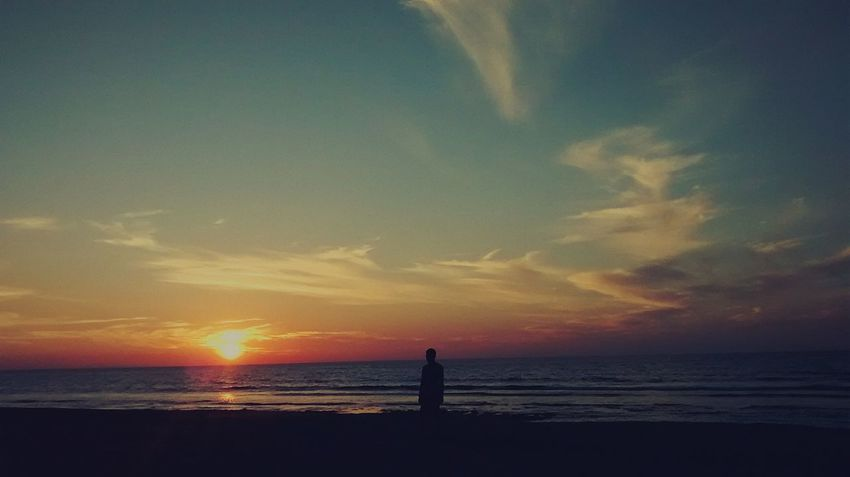EyeEmNewHere Beach Sunset Silhouette Sea Vacations Scenics Beauty In Nature Perspectives On Nature