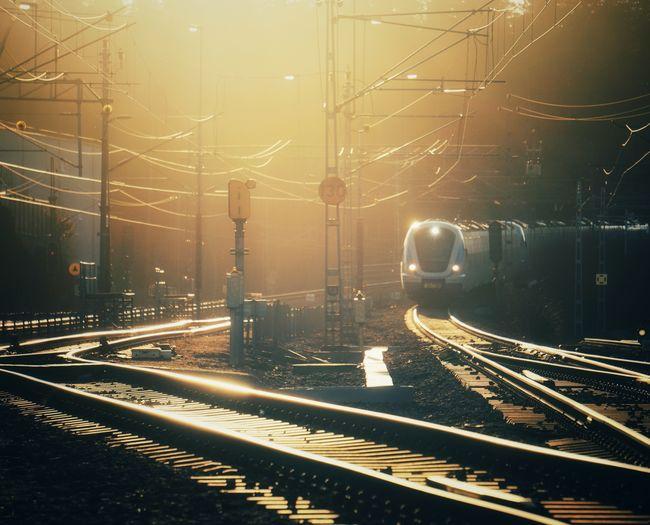 Railroad tracks in city at dusk