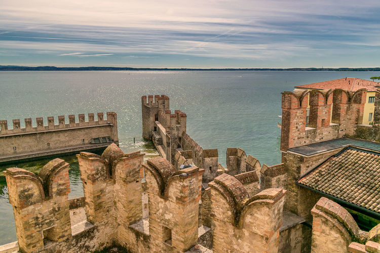 Ancient Castle Harbor Harbour Lago Di Garda Building Building Exterior Coulds Coulds And Sky Historic History Italy Lake Landscape Roman Sky Summer Water