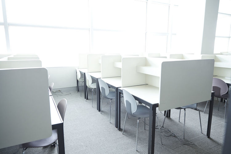 Empty chairs and table at office
