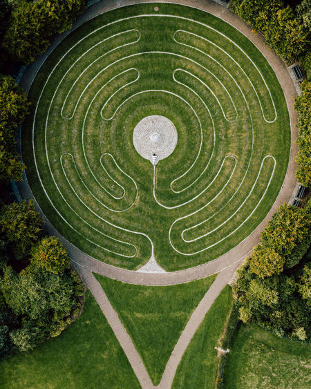 High angle, drone view of one person in maze
