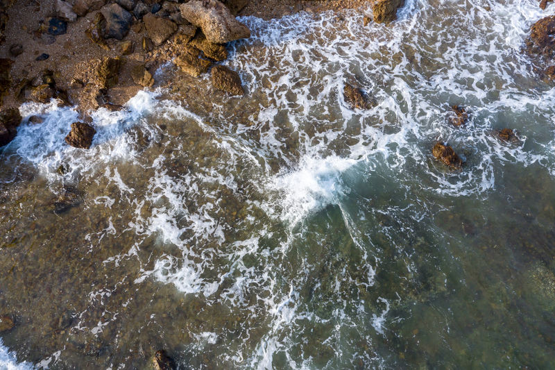 High angle view of waterfall in sea