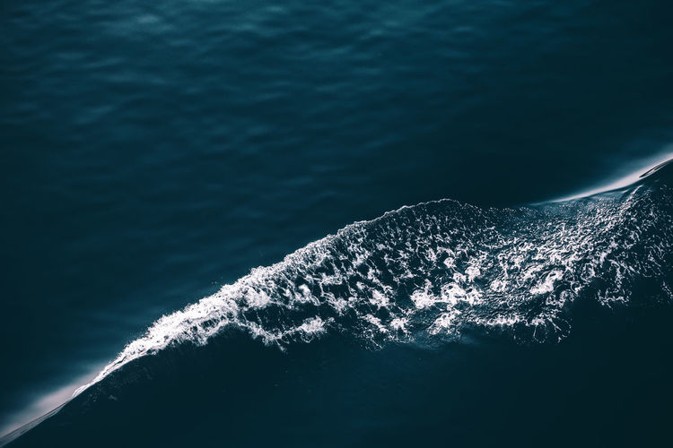 High angle view of wake in sea