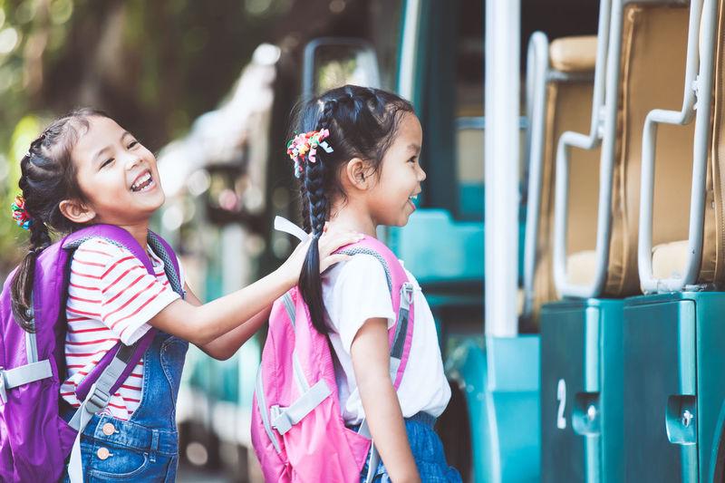Happy Schoolgirls Boarding Miniature Train