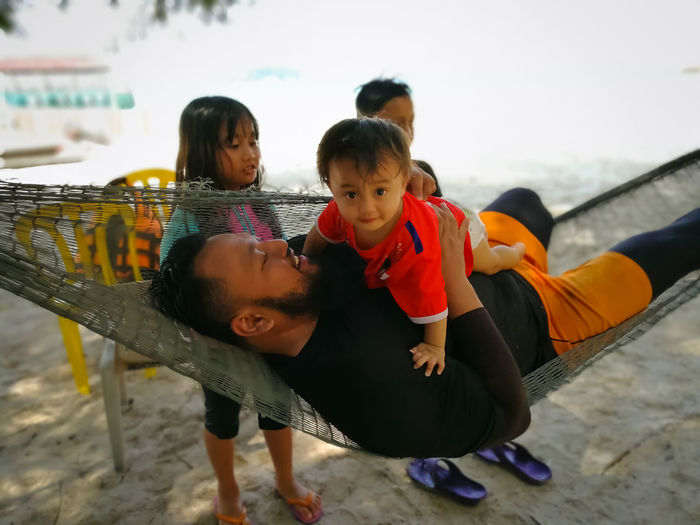 Pulau Redang, Terengganu. Childhood Child Real People Females Women Leisure Activity Full Length Togetherness Girls Lifestyles Boys Family Bonding Males  Group Of People Mother Emotion Smiling Innocence Sister Positive Emotion Outdoors